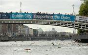 19 September 2015; Participants swim under the Ha'Penny Bridge during the Dublin City Liffey Swim. Dublin City Liffey Swim. Dublin. Picture credit: Cody Glenn / SPORTSFILE