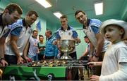 21 September 2015; Dublin players from left, Jack McCaffrey, Denis Bastick, Brian Fenton and Nicky Devereux with 6 year old Dylan Murphy, from Clondalkin, Co. Dublin, during a visit from the GAA Football All-Ireland Champions Dublin to Our Lady's Children's Hospital, Crumlin, Dublin. Picture credit: David Maher / SPORTSFILE