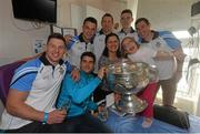 21 September 2015; Dublin players, from left, Philly McMahon, Bernard Brogan, Eric Lowndes, Denis Bastick, Brian Fenton and Nicky Devereux meet 9 year old Cesara Maria Focsa and mother Elena during a visit from the GAA Football All-Ireland Champions Dublin to Temple Street Children's Hospital. Temple Street, Dublin. Picture credit: Ramsey Cardy / SPORTSFILE