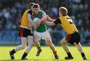 18 April 2009; Neill Douglas, Mayo, in action against Joseph Murphy, left, and Niall Higgins, Down. Cadbury Under 21 All-Ireland Football Championship Semi-Final, Mayo v Down, Pearse Park, Longford. Picture credit: Pat Murphy / SPORTSFILE
