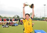 26 April 2009; Pembroke Wanderers captain Alan Giles lifts the Irish Senior cup at the end of the game. Irish Senior Men's Cup Final, Cookstown v Pembroke Wanderers, National Hockey Stadium, UCD, Dublin. Picture credit: David Maher / SPORTSFILE