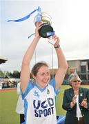 26 April 2009; Lisa Jacob, UCD captain, lifts the cup after victory over Pegasus. ESB Irish Senior Women's Cup Final, Pegasus v UCD, National Hockey Stadium, UCD, Dublin. Picture credit: David Maher / SPORTSFILE