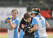 26 April 2009; Mary Logue, UCD head coach, has water thrown over her as UCD celebrate at the end of the game. ESB Irish Senior Women's Cup Final, Pegasus v UCD, National Hockey Stadium, UCD, Dublin. Picture credit: David Maher / SPORTSFILE