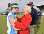 26 April 2009; Lisa Jacob, left, UCD captain, celebrates after victory over Pegasus with the 1951 winning UCD captain Patrica Horne. ESB Irish Senior Women's Cup Final, Pegasus v UCD, National Hockey Stadium, UCD, Dublin. Picture credit: David Maher / SPORTSFILE