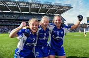 27 September 2015; Waterford players Sinead Ryan, left, Mairead Wall, and Hannah Landers, right, celebrate after the game. TG4 Ladies Football All-Ireland Intermediate Championship Final, Kildare v Waterford, Croke Park, Dublin. Picture credit: Paul Mohan / SPORTSFILE