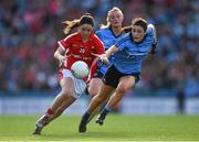 27 September 2015; Eimear Scally, Cork, is tackled by Olwen Carey, Dublin. TG4 Ladies Football All-Ireland Senior Championship Final, Croke Park, Dublin. Picture credit: Ramsey Cardy / SPORTSFILE