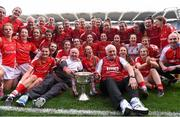 27 September 2015; The Cork team together with manager Eamonn Ryan and selector Frankie Honohan, left, celebrate with the Brendan Martin Cup after the game TG4 Ladies Football All-Ireland Senior Championship Final, Croke Park, Dublin. Picture credit: Paul Mohan / SPORTSFILE