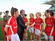 27 September 2015; An Taoiseach Enda Kenny shakes hands with Vera Foley, Cork, before the game. TG4 Ladies Football All-Ireland Senior Championship Final, Croke Park, Dublin. Picture credit: Dáire Brennan / SPORTSFILE