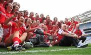 27 September 2015; The Cork team celebrate with the Brendan Martin cup after the game. TG4 Ladies Football All-Ireland Senior Championship Final, Croke Park, Dublin. Picture credit: Dáire Brennan / SPORTSFILE