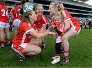 27 September 2015; Cork players Aisling Hutchings, left, Róisín Phelan, second left, and Vera Foley with 5 year-old niece Layla. TG4 Ladies Football All-Ireland Senior Championship Final, Croke Park, Dublin. Picture credit: Ramsey Cardy / SPORTSFILE