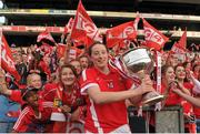 27 September 2015; Áine O'Sullivan, Cork, celebrates with the Brendan Martin cup after the game. TG4 Ladies Football All-Ireland Senior Championship Final, Croke Park, Dublin. Picture credit: Dáire Brennan / SPORTSFILE