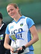 26 April 2009; UCD's Roisin Flinn holds her Player of the Match cup. ESB Irish Senior Women's Cup Final, Pegasus v UCD, National Hockey Stadium, UCD, Dublin. Picture credit: David Maher / SPORTSFILE