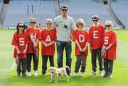 30 April 2009; Recently appointed Ipswich Town manager and Irish soccer legend Roy Keane with puppy in training Ella and schoolchildren, from left, Emily O'Connell, age 11, from Blakestown, Dublin, Roisin Ni Chaoimh, age 12, from Blanchardstown, Dublin, Adam Fagan, age 10, from Rathoath, Co. Meath, Rebecca Nic Liam, age 9, from Clonsilla, Dublin, Cian O Ceallaigh, age 12, from Castleknock, Dublin and Caoimhe Ryan, age 11, from Castleknock, Dublin, at the official launch of the seventh annual Irish Guide Dogs for the Blind Specsavers Shades 2009 campaign. The campaign raises funds for the training of guide and assistant dogs and centres around a week of fundraising nationwide which kicks off on Monday 4th May 2009. Croke Park, Dublin. Picture credit: Brendan Moran / SPORTSFILE