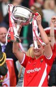 27 September 2015; Bríd Stack, Cork, lifts the Brendan Martin cup. TG4 Ladies Football All-Ireland Senior Championship Final, Croke Park, Dublin. Picture credit: Ramsey Cardy / SPORTSFILE