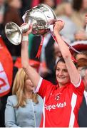 27 September 2015; Annie Walsh, Cork, lifts the Brendan Martin cup. TG4 Ladies Football All-Ireland Senior Championship Final, Croke Park, Dublin. Picture credit: Ramsey Cardy / SPORTSFILE