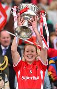 27 September 2015; Cork's Rena Buckley lifts the Brendan Martin cup. TG4 Ladies Football All-Ireland Senior Championship Final, Croke Park, Dublin. Picture credit: Ramsey Cardy / SPORTSFILE