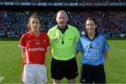 27 September 2015; Referee John Niland with team captains, Cork's Ciara O'Sullivan and Dublin's Lyndsey Davey. TG4 Ladies Football All-Ireland Senior Championship Final, Croke Park, Dublin. Picture credit: Ramsey Cardy / SPORTSFILE