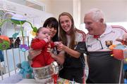 28 September 2015; 28 week old Josh O'Callaghan, from Watergrasshill, Co. Cork, and his mother Mags with Cork ladies footballer Kate Leneghan and team manager Eamonn Ryan during a visit by the TG4 Ladies Football All-Ireland Senior Champions to  Crumlin Children's Hospital, Crumlin, Dublin. Picture credit: Matt Browne / SPORTSFILE
