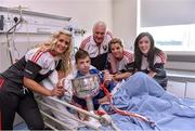 28 September 2015; 12 year old Kieran McCarthy, from Watergrasshill, Co. Cork, with Cork ladies footballers Brid Stack, team manager Eamonn Ryan, Valerie Mulcahy and team captain Ciara O'Sullivan during a visit by the TG4 Ladies Football All-Ireland Senior Champions to  Crumlin Children's Hospital, Crumlin, Dublin. Picture credit: Matt Browne / SPORTSFILE