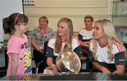 28 September 2015; Aimee-Lousie Fenton, from Midleton, Co. Cor , with Cork Ladies footballers Roisin Phelan and Brid Stack during a visit by the TG4 Ladies Football All-Ireland Senior Champions to Temple Street Hospital, Temple Street, Dublin. Picture credit: Sam Barnes / SPORTSFILE