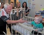 28 September 2015; Joshua McDonald, 9 months old, from Limerick City, Co. Limerick, with Cork ladies football manager Eamonn Ryan and players, from left, Aisling Hutchings, Rois'n Phelan and Ciara O'Sullivan during a visit by the TG4 Ladies Football All-Ireland Senior Champions to Temple Street Hospital, Temple Street, Dublin. Picture credit: Sam Barnes / SPORTSFILE