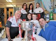28 September 2015; Shayne Moran, age 5, from Leitrim Village, Co. Leitrim, with his parents and Cork ladies football manager Eamonn Ryan and players, from left,  Sinead Cotter, Aisling Barrett and Aisling Hutchings  during a visit by the TG4 Ladies Football All-Ireland Senior Champions to Temple Street Hospital, Temple Street, Dublin. Picture credit: Sam Barnes / SPORTSFILE