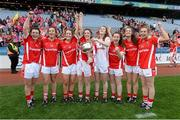27 September 2015; Cork players, from left, Doireann O'Sullivan, Brid O'Sullivan, Roisin O'Sullivan, Ciara O'Sullivan, Méabh O'Sullivan, Aine Hayes, Jennifer Barry and Maire O'Callaghan with the Brendan Martin cup. TG4 Ladies Football All-Ireland Senior Championship Final, Croke Park, Dublin. Picture credit: Ramsey Cardy / SPORTSFILE