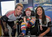28 September 2015; Oran Neacy, age 4, from Ardee, Co. Louth, with Cork ladies footballers Valerie Mulcahy, left, and Ciara O'Sullivan during a visit by the TG4 Ladies Football All-Ireland Senior Champions to Temple Street Hospital, Temple Street, Dublin. Picture credit: Sam Barnes / SPORTSFILE