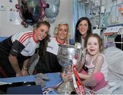 28 September 2015; Isabel O'Dwyer, from Dublin, with Cork ladies footballers, from left, Aisling Hutchings, Brid Stack and Ciara O'Sullivan during a visit by the TG4 Ladies Football All-Ireland Senior Champions to Temple Street Hospital, Temple Street, Dublin. Picture credit: Sam Barnes / SPORTSFILE