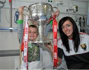 28 September 2015; Leon Daly, age 6, from Dublin City, with Cork ladies footballer Aisling Barrett during a visit by the TG4 Ladies Football All-Ireland Senior Champions to Temple Street Hospital, Temple Street, Dublin. Picture credit: Sam Barnes / SPORTSFILE