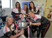 28 September 2015; Eoin Ward, age 12, from Clonard, Co. Meath, with Cork ladies footballers, from left, Roisin Phelan, Sinead Cotter, Aisling Hutchings, Ciara O'Sullivan and Valerie Mulcahy during a visit by the TG4 Ladies Football All-Ireland Senior Champions to Temple Street Hospital, Temple Street, Dublin. Picture credit: Sam Barnes / SPORTSFILE