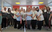 28 September 2015; Members of staff on The Day Ward pose for a photo with the Eamonn Ryan and members of the Cork team during a visit by the TG4 Ladies Football All-Ireland Senior Champions to Temple Street Hospital, Temple Street, Dublin. Picture credit: Sam Barnes / SPORTSFILE
