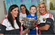 28 September 2015; Mason Mulligan, age 3, from Pearse Street, Co. Dublin, with Cork ladies footballers, from left, Ciara O'Sullivan, Aisling Hutchings and Brid Stack during a visit by the TG4 Ladies Football All-Ireland Senior Champions to Temple Street Hospital, Temple Street, Dublin. Picture credit: Sam Barnes / SPORTSFILE
