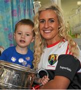 28 September 2015; Mason Mulligan, age 3, from Pearse Street, Co. Dublin, with Cork ladies footballer Brid Stack during a visit by the TG4 Ladies Football All-Ireland Senior Champions to Temple Street Hospital, Temple Street, Dublin. Picture credit: Sam Barnes / SPORTSFILE