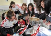28 September 2015; Fareed Nahari, Age 2, from Clonsilla, Co. Dublin, with Cork ladies footballers, from left, Aine Terry, Aisling Hutchings, Ciara O'Sullivan, Sinead Cotter and Aisling Barrett during a visit by the TG4 Ladies Football All-Ireland Senior Champions to Temple Street Hospital, Temple Street, Dublin. Picture credit: Sam Barnes / SPORTSFILE