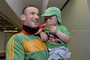 9 June 2013; Ireland's John Joe Nevin, who won gold in the 56kg Bantamweight division, with his 3-year-old son Martin, on his arrival home from the EUBC European Men's Boxing Championships 2013 in Belarus. IABA Welcome Home the EUBC European Men's Boxing Championships 2013 Team, Dublin Airport, Dublin. Picture credit: Matt Browne / SPORTSFILE