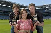 10 June 2013; Laois hurler Cahir Healy, left, and London footballer Mark Gottsche are presented with their GAA / GPA Player of the Month Award, sponsored by Opel, for May, by Laura Condron, Senior Brand and PR Manager Opel Ireland. Croke Park, Dublin. Picture credit: Barry Cregg / SPORTSFILE
