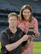 10 June 2013; London footballer Mark Gottsche is presented with his GAA / GPA Player of the Month Award, sponsored by Opel, for May, by Laura Condron, Senior Brand and PR Manager Opel Ireland. Croke Park, Dublin. Picture credit: Barry Cregg / SPORTSFILE