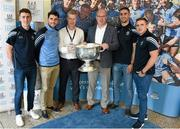 1 October 2015; Dublin players, from left, Cormac Costello, Bernard Brogan, James McCarthy, and Davy Byrne accompanied by Aidan Connaughton, AIG Consumer Lines Manager, EMEA, and Declan O'Rourke, General Manager, AIG Ireland, right, were at AIG Insurance's offices in Dublin today for a reception to mark their GAA Football All-Ireland Championship success. AIG, North Wall Quay, Dublin. Picture credit: Stephen McCarthy / SPORTSFILE