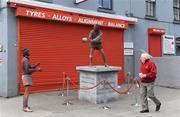 2 May 2009; A supporter passes one of the Heineken Moment of Trugh statues outside Croke Park. Heineken Cup Semi-Final, Munster v Leinster, Croke Park, Dublin. Picture credit: Brendan Moran / SPORTSFILE