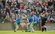 4 October 2015; Peter Nixon, Sean O'Mahony's, in action against Ray Finnegan, Dessie Finnegan and Paddy Keenan, St Patrick's. Louth County Senior Football Championship Final, Sean O'Mahony's v St Patrick's, Gaelic Grounds, Drogheda, Co. Louth. Picture credit: Seb Daly / SPORTSFILE