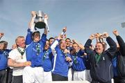 10 May 2009; Crumlin United FC captain Derek Griffin lifts the FAI Umbro Intermediate Cup as he celebrates with team-mates and officials. FAI Umbro Intermediate Cup Final, Crumlin United FC v Bluebell United FC, Tallaght Stadium, Dublin. Picture credit: David Maher / SPORTSFILE