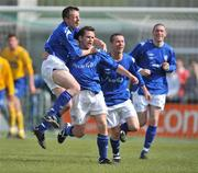 10 May 2009; Derek Griffin, second from left, Crumlin United FC, celebrates after scoring his side's third and winning goal with team-mates Ciaran Kenna, left and Paul McCabe. FAI Umbro Intermediate Cup Final, Crumlin United FC v Bluebell United FC, Tallaght Stadium, Dublin. Picture credit: David Maher / SPORTSFILE
