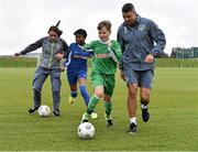 5 October 2015; Pictured are Republic of Ireland players Aine O'Gorman and Jonathan Walters with Temilade Fteuga, age 11, and Tadhg Curran, age 11, from St. Bernadette's Junior School, Clondalkin, Co. Dublin. The Republic of Ireland players made a surprise appearance at an exclusive SPAR training session at the National Sports Campus in advance of the Republic of Ireland vs Germany game on Thursday. SPAR is the Official Convenience Retail Partner of the FAI. FAI National Training Centre, National Sports Campus, Abbotstown, Dublin. Picture credit: David Maher / SPORTSFILE