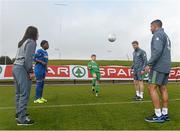 5 October 2015; Pictured are Republic of Ireland players Aine O'Gorman, Eunan O'Kane and Jonathan Walters with Temilade Fetuga, age 11, and Tadhg Curran, age 11, from St. Bernadette's Junior School, Clondalkin, Co. Dublin. The Republic of Ireland players made a surprise appearance at an exclusive SPAR training session at the National Sports Campus in advance of the Republic of Ireland vs Germany game on Thursday. SPAR is the Official Convenience Retail Partner of the FAI. FAI National Training Centre, National Sports Campus, Abbotstown, Dublin. Picture credit: David Maher / SPORTSFILE
