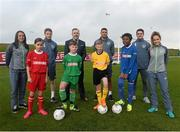 5 October 2015; Pictured are Republic of Ireland players Aine O'Gorman and Julianne Russell, Eunan O'Kane, Jonathan Walters and Robbie Brady with children from left, Aoife Farrell, age 10, Tadhg Curran, age 11, Lee Reid, age 11, and Temilade Fetuga, age 11, from St. Bernadette's Junior School, Clondalkin, Co. Dublin, with Colin Donnelly, Sales Director Spar Ireland. The Republic of Ireland players made a surprise appearance at an exclusive SPAR training session at the National Sports Campus in advance of the Republic of Ireland vs Germany game on Thursday. SPAR is the Official Convenience Retail Partner of the FAI. FAI National Training Centre, National Sports Campus, Abbotstown, Dublin. Picture credit: David Maher / SPORTSFILE