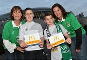 8 October 2015; Pictured is Gavin Mulvihill, aged 11, from Knocklyon, Dublin 16, alongside his mum, Julie, left, and Donncha O'Sullivan, aged 8, from Kenmare, Co. Kerry,  alongside his mum Sinead O'Donovan, at the Aviva Stadium. Gavin and Donncha  won a McDonald's Future Football competition to become a flagbearer for the crucial Ireland v Germany European Championship Qualifier at the Aviva Stadium. McDonald's FAI Future Football is a programme designed to support grassroots football clubs by enriching the work they do at local level. Over 10,000 boys and girls from 165 football clubs in Ireland will take part this year, generating 70,000 additional hours of activity. Aviva Stadium, Lansdowne Road, Dublin. Picture credit: Ramsey Cardy / SPORTSFILE