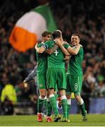 8 October 2015; Jeff Hendrick, John O'Shea and James McCarthy, Republic of Ireland, celebrate their team's victory at the final whistle. UEFA EURO 2016 Championship Qualifier, Group D, Republic of Ireland v Germany. Aviva Stadium, Lansdowne Road, Dublin. Picture credit: Seb Daly / SPORTSFILE