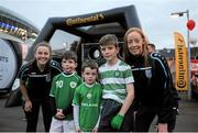 8 October 2015; Pictured at the Continental Tyres fanzone area at the Aviva Satdium were Continental Tyres Women's National League and Irish women's national team players, Karen Duggan and Julie-Ann Russell ahead of the crucial Republic of Ireland v Germany UEFA qualification game. The players along with their UCD Waves teammates Niamh Walsh and Ciara Grant, challenged fans going into the match to a penalty shoot competition in association with Continental Tyres - proud supporters of Irish womens football and official partner of the FAI. Pictured are David, Patrick and Killian Curral, Blackrock, Co. Dublin, with UCD Waves players Ciara Grant and Niamh Walsh. For more infortmation on Continental Tyres visit www.continental-tyres.co.uk. Aviva Stadium, Lansdowne Road, Dublin. Picture credit: Seb Daly / SPORTSFILE