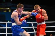 9 October 2015; Joseph Ward, left, Ireland, exchanges punches with Oleksandr Khyzhniak, Ukraine, during their Men's Light Heavyweight 81kg last 16 bout. AIBA World Boxing Championships, Ali Bin Hamad Al Attiyah Arena, Doha, Qatar. Picture credit: Paul Mohan / SPORTSFILE